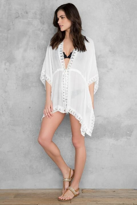 c46dee68e8a09 The Tahiti Lace Kimono Swim Cover-Up features a dramatic neck plunge with  lace trimmed wide sleeves. Get this unique beach cover-up now!