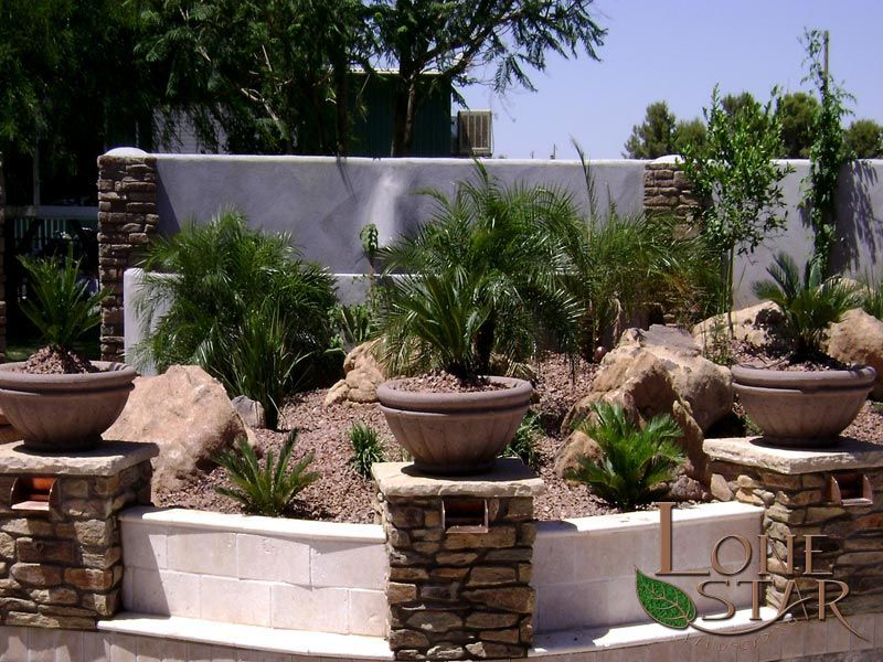 outdoor decor natural stone veneer and copper pool scuppers accent this travertine wall in scottsdale az