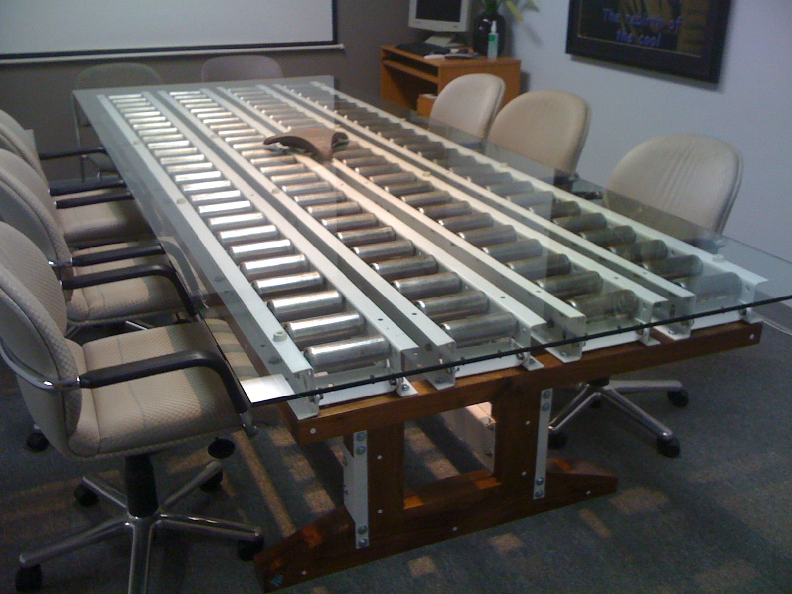 Nautilus Conference Table. Steel Conveyor Pins, Pallet Racking Beams,  Walnut, Glass.