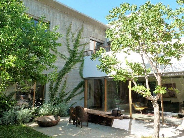 veranda haus begrünte fassade beton kletterpflanzen #traumhäuser
