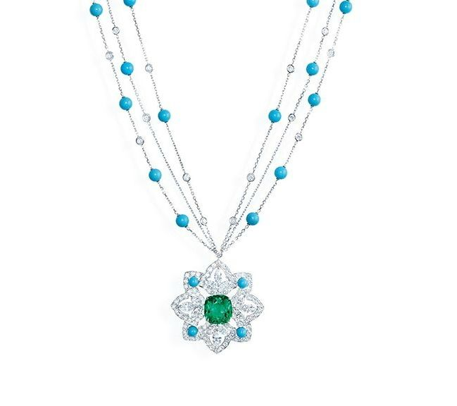 """Piaget """"Secrets & Lights"""" Necklace in 18K white gold set with 1 cushion-cut emerald (approx. 11.16 cts), 12 marquise-cut diamonds (approx. 4.20 cts), 32 turquoise beads (approx. 11.10 cts) and 151 brilliant-cut diamonds (approx. 9.86 cts)."""