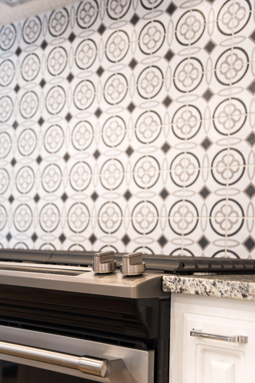 Decorative Tiles For Backsplash Endearing Black And White Decorative Tile Backsplash Behind Double Range Decorating Inspiration