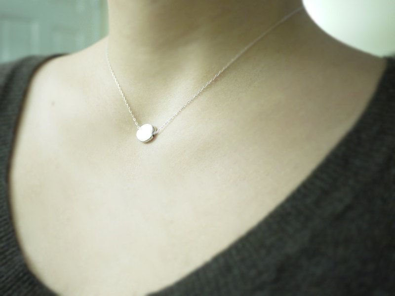 Silver disc necklace - flat circle lentil on sterling silver chain - modern simple jewlery. $25.00, via Etsy.