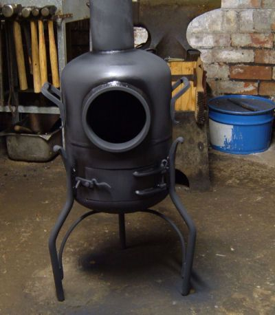Made from an old propane tank. & Woodburning stove. | Wood charcoal Stove and Woods