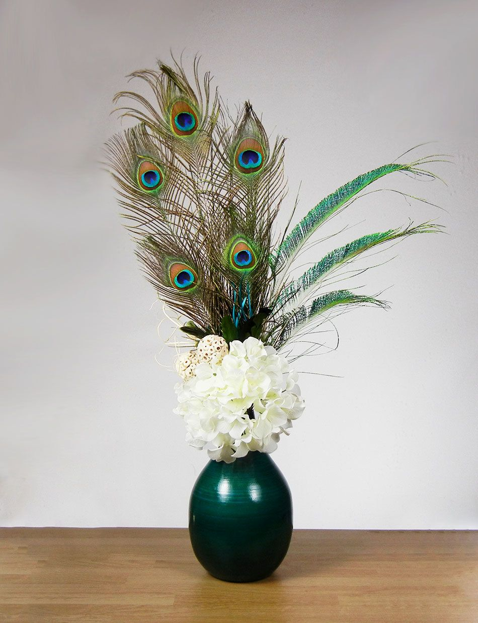 New teal peacock feather floral arrangement white