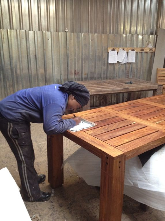 27. Work order records are completed as items progress through each station in the factory. Here another completed Zondi table is being signed off, ready to be packed and delivered to its new owner.