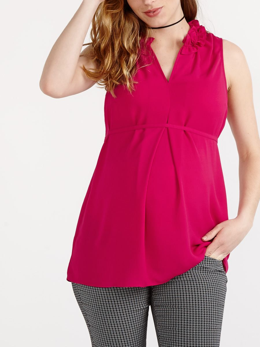 00b8b3517298b Brighten your workwear with this vibrant maternity blouse! You'll love its  V-neck with ruffled detailing, romantic rasberry hue and tie at waist that  ...
