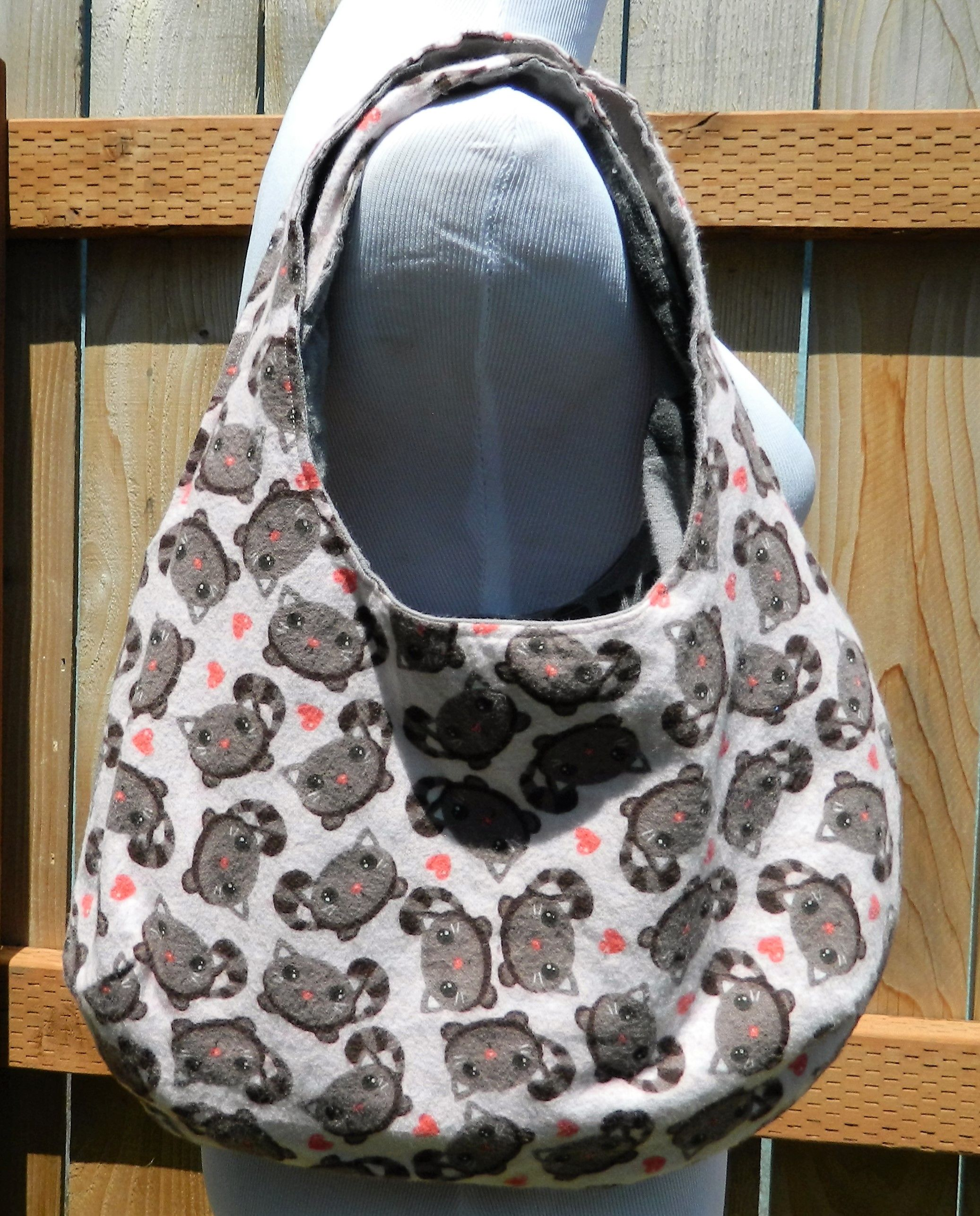 An adorable grey kitties pink purse is a puuur-fect gift for a cat lover.