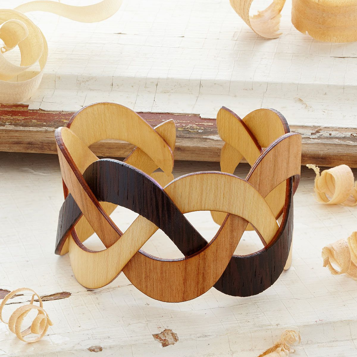 This striking, wooden cuff bracelet is made from thin, woven bands of cherry, walnut and rosewood.
