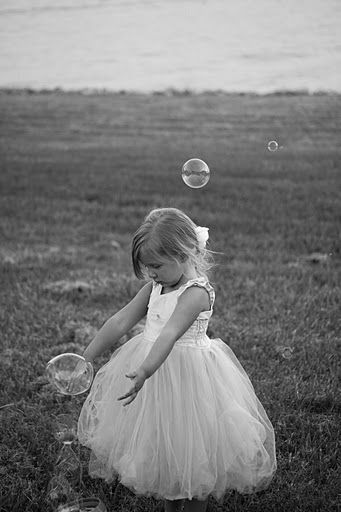 flower girls playing with bubbles, bubble machine?