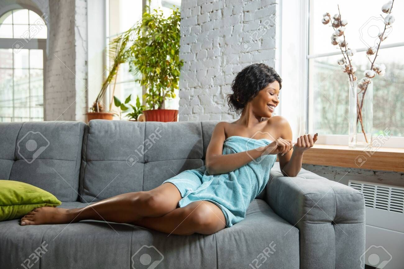 Beauty Day African American Woman In Towel Prepared For Doing Her Daily Skincare Routine At Home Sitting In 2020 Daily Skin Care Routine Skin Care Routine Skin Care