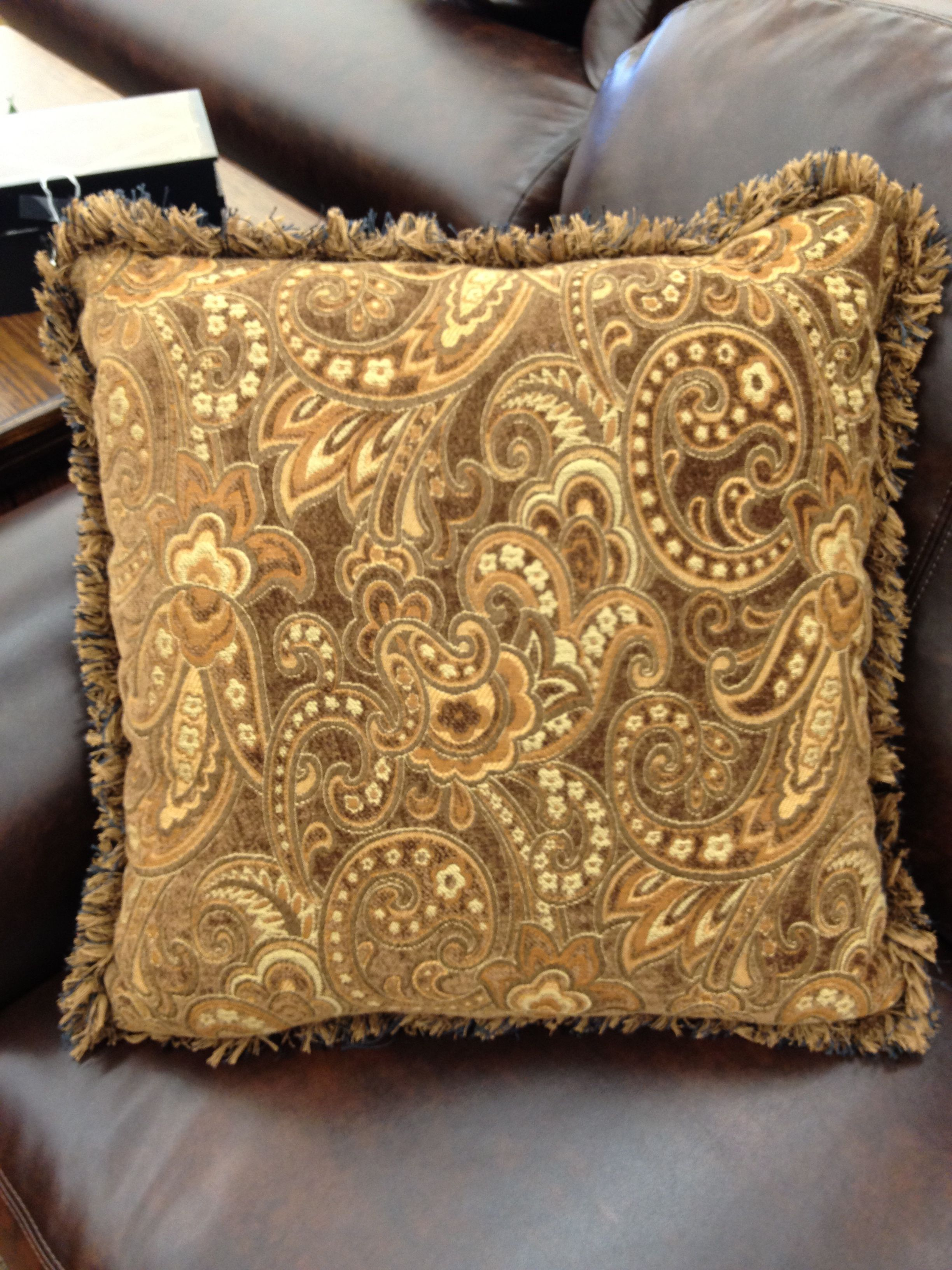 Paisley brown patterned throw pillow with fringe.