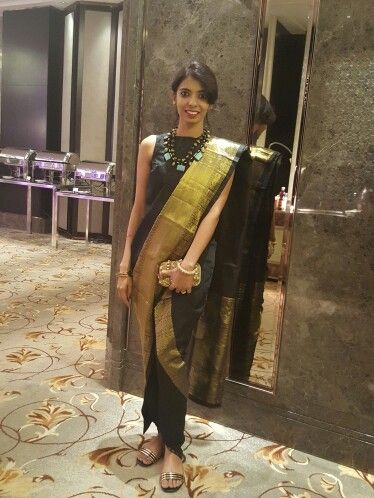 Black and gold dhoti saree. We love the contemporary twist to the classic kancheepuram silk. How much more versatile can it get.