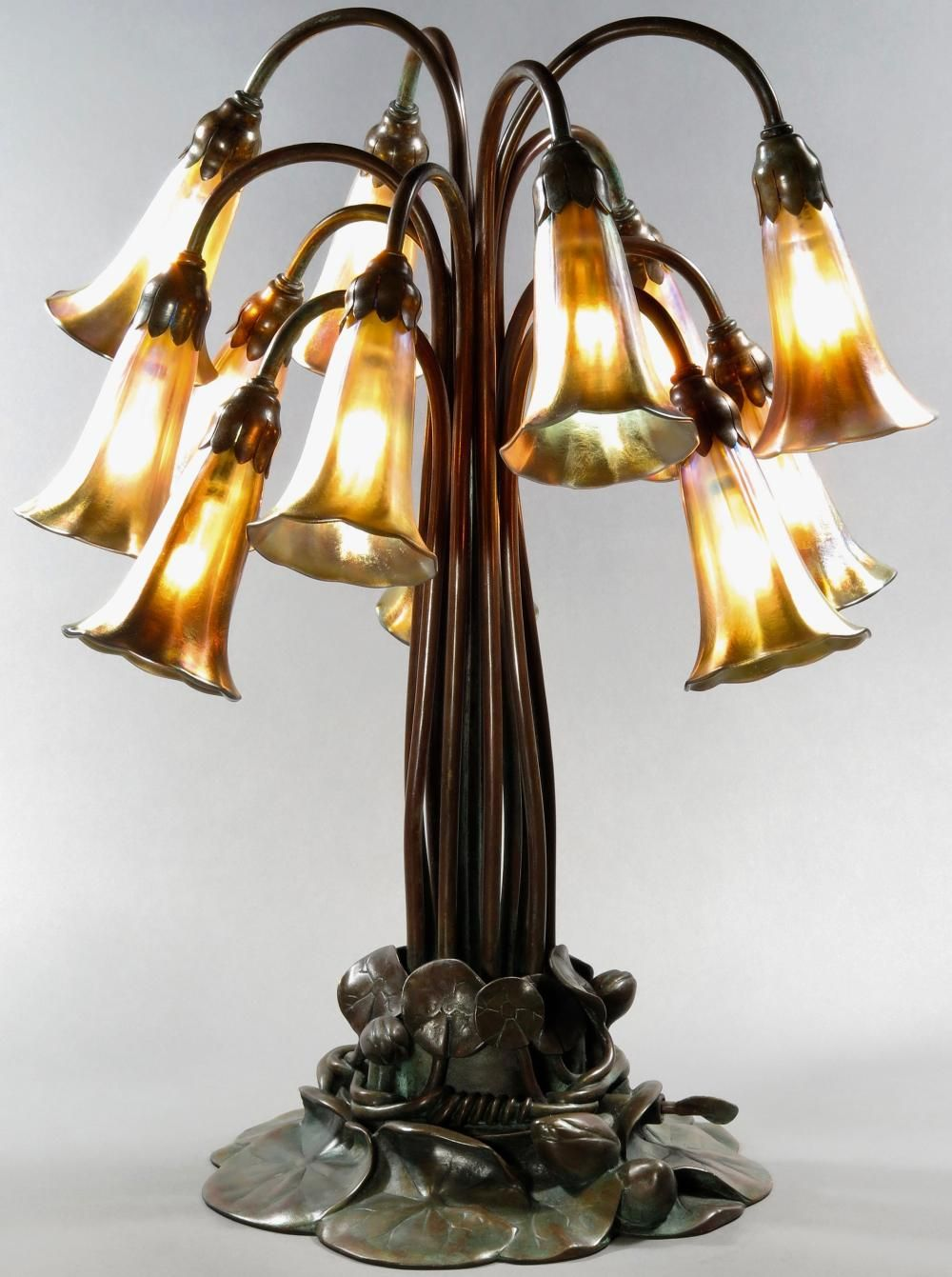 Tiffany Studios 12 Light Lily Lamp In Patina In 2020 Lamp Table Lamp Bronze Lamp