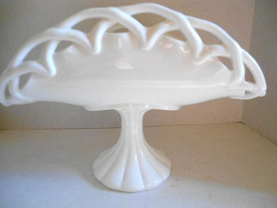https://www.etsy.com/listing/243315984/white-pedestal-milk-glass-banana-keeper?ref=shop_home_active_23