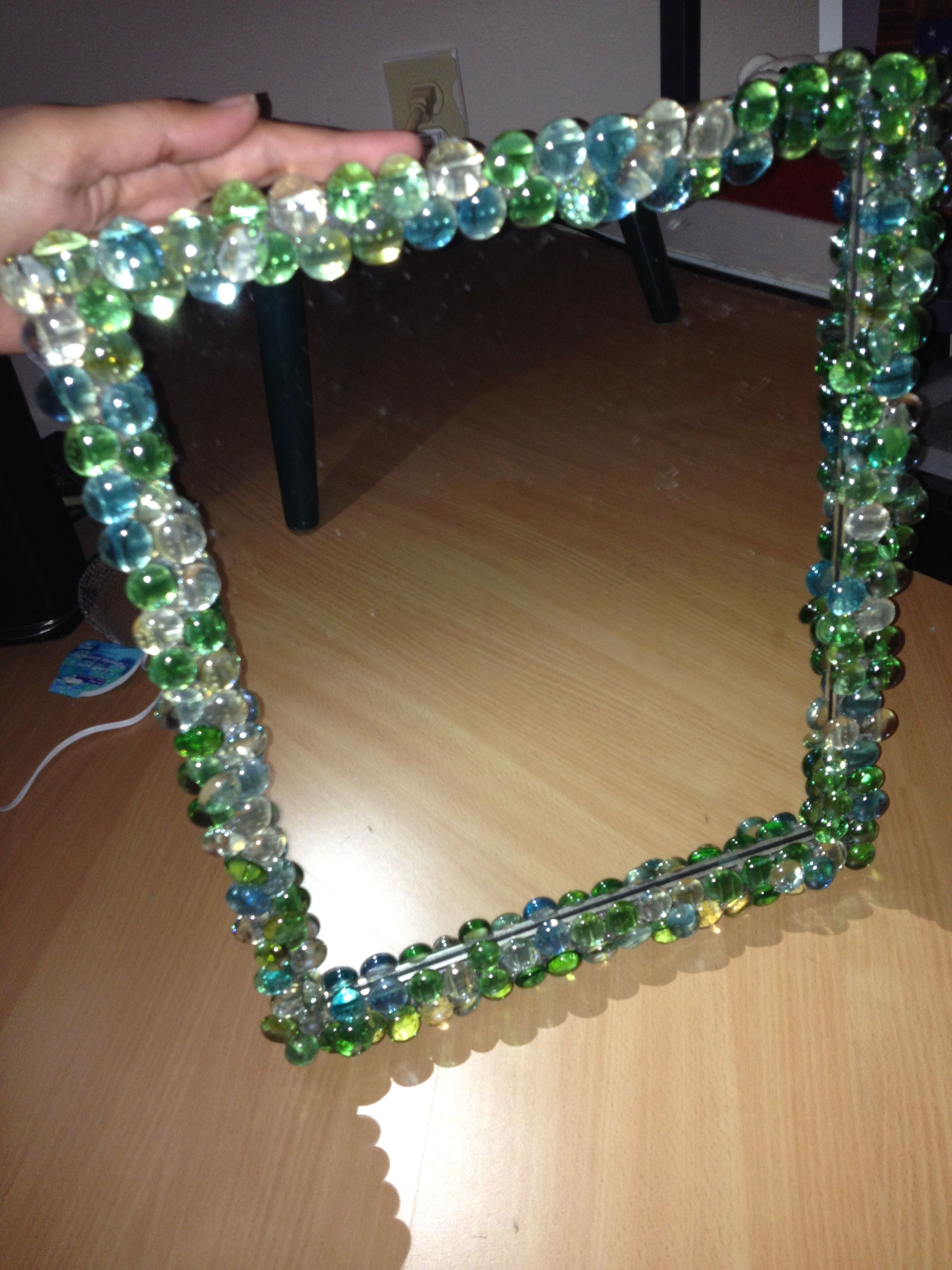 Bejeweled a cheap mirror with dollars store glass pebbles for Dollar store mirror craft