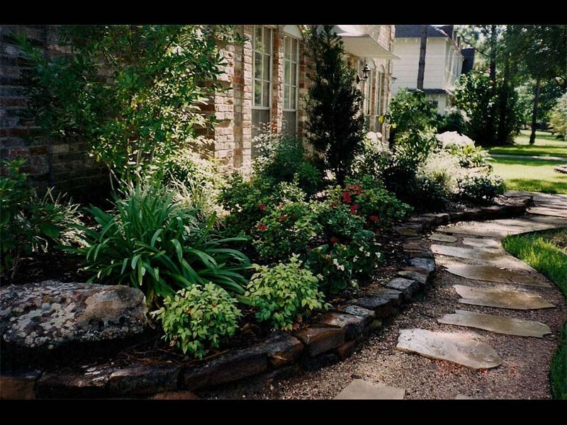 Landscaping Pathways walkway mix of gravel and natural stone. rock borders to continue
