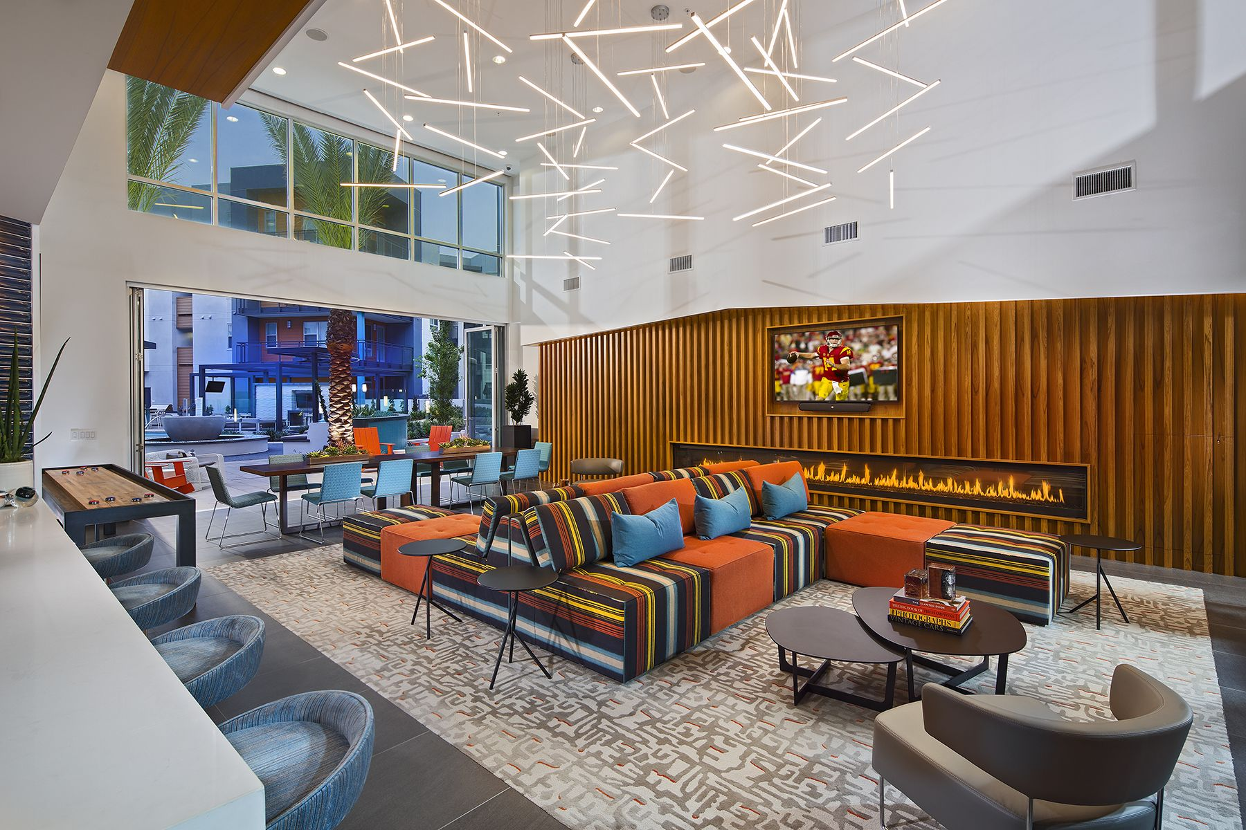 The Club Room Is Outfitted In Bright Earthy Colors Offset By Splashes Of Blue On Accent Pieces Like The Pillo Hostels Design Looking For Apartments Home Decor