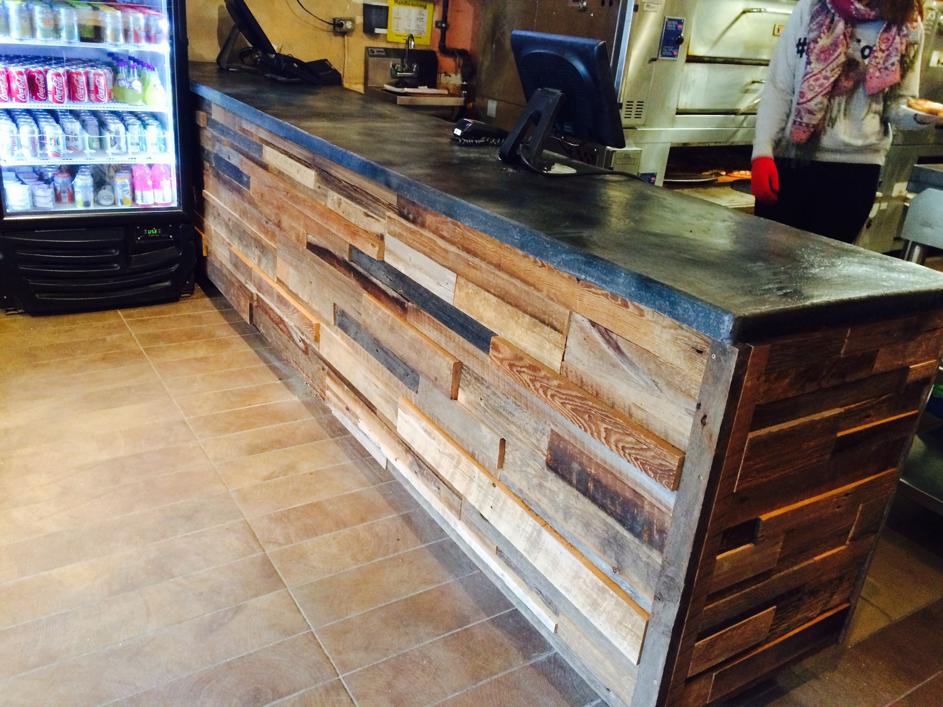 Reclaimed wood counter area for King Slice Pizza in Toronto by