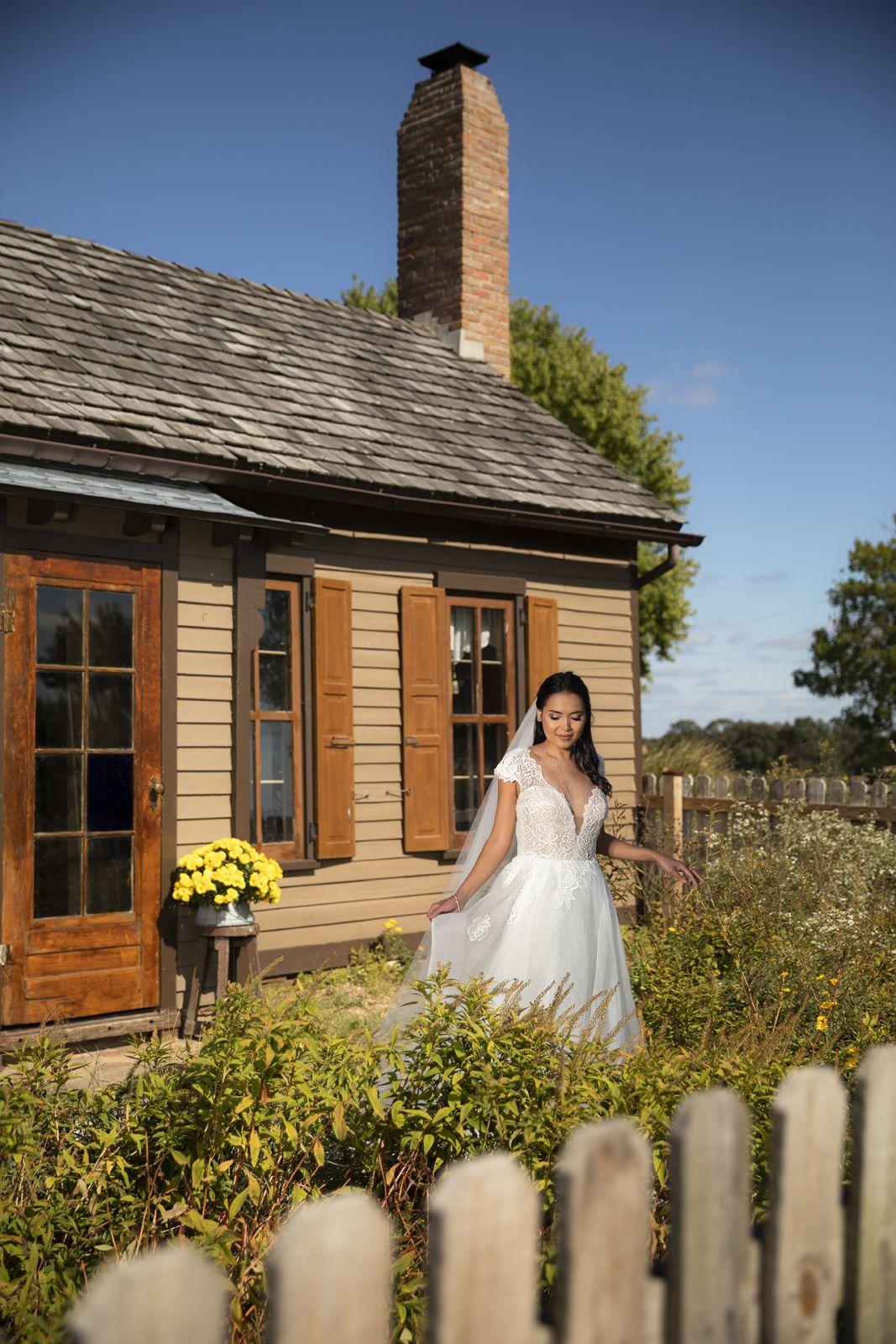 Bride in the wildflowers in 2020 Barn wedding reception
