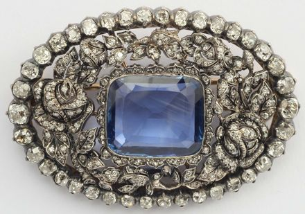 Sapphire and diamond brooch, set with central Sri Lankan sapphire, 88 old cut diamonds, mounted in silver, gold