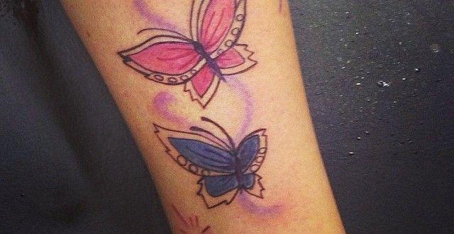 Schmetterling Tattoo an der Wade