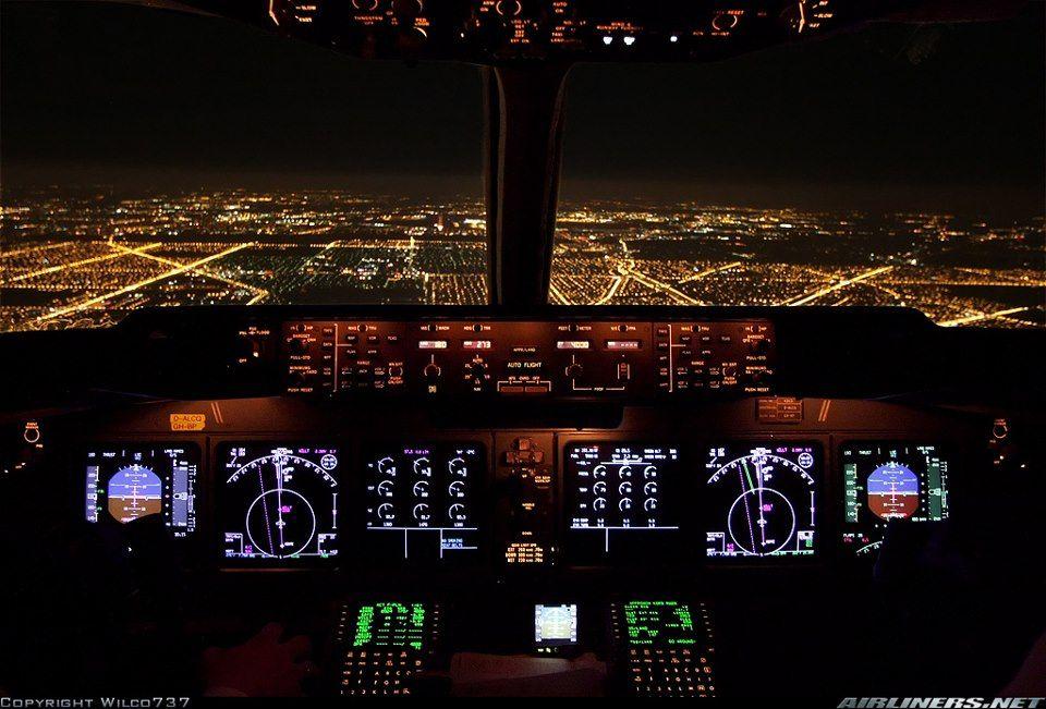 Different View Of Nighttime City Lights Cockpit Flight Deck Photo