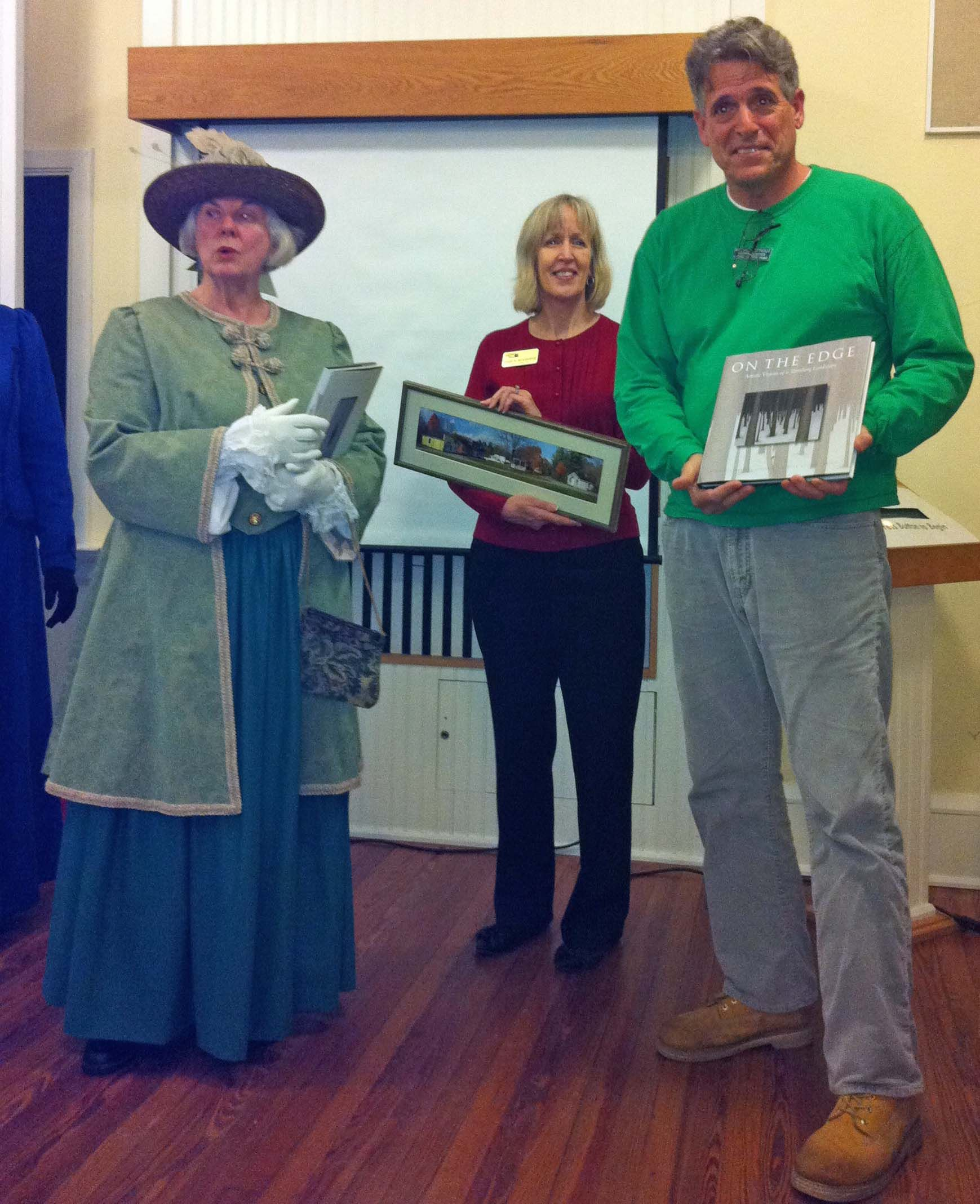 Janet Knowles of the Historic Heritage Village of Hamilton, Ontario exchanges gifts with historical Spanish Point leaders
