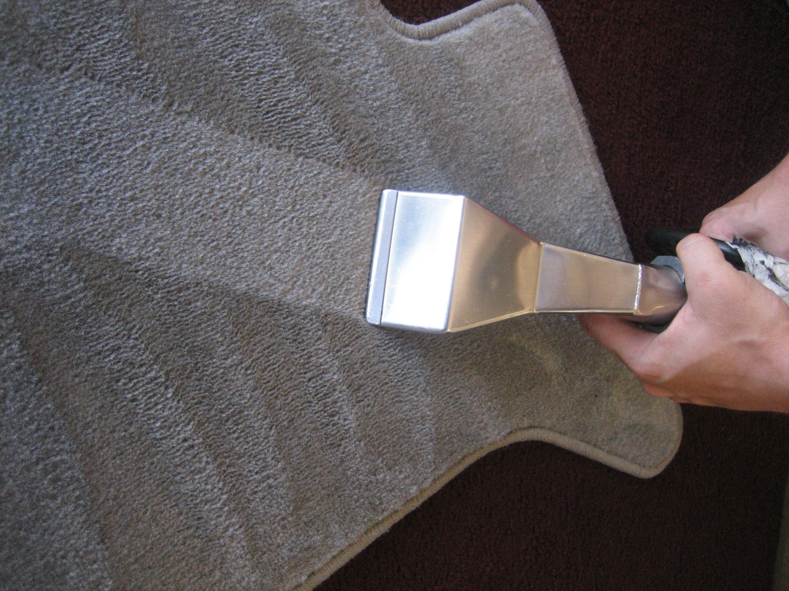 Clean carpet or upholstery stains by applying a foam