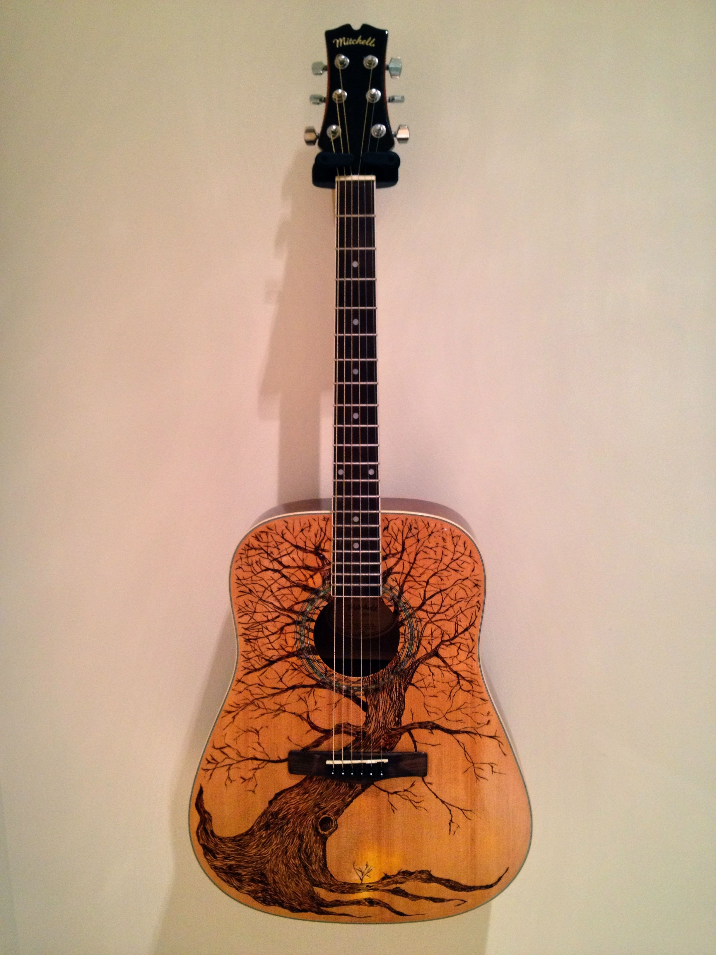 Art guitar Pyrography I strip the guitar top and wood burn the design and