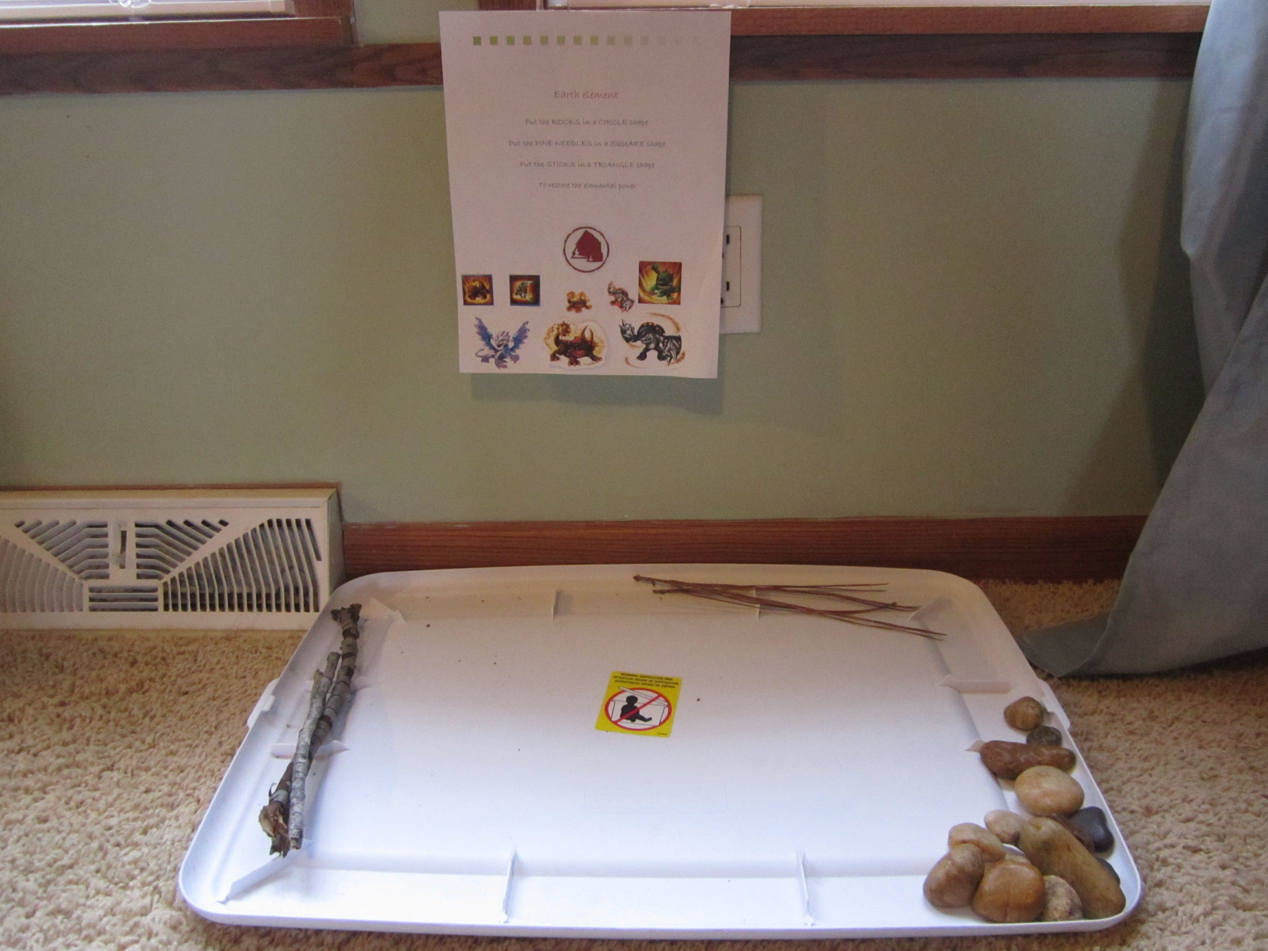 skylanders party , earth element, put rocks in a certain shape , then follow with pine needles and sticks in certain shapes