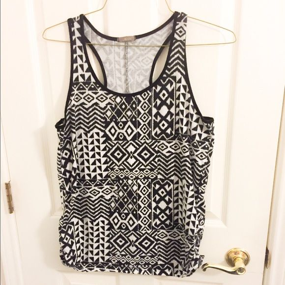 Tribal Print Racerback tank top Tag is missing that states size, but I would say this is an L/XL. Fitted tank with cinched sides. Black and white. Good used condition. Offers welcomed through offer tab, discounts when bundled!  Tops Tank Tops