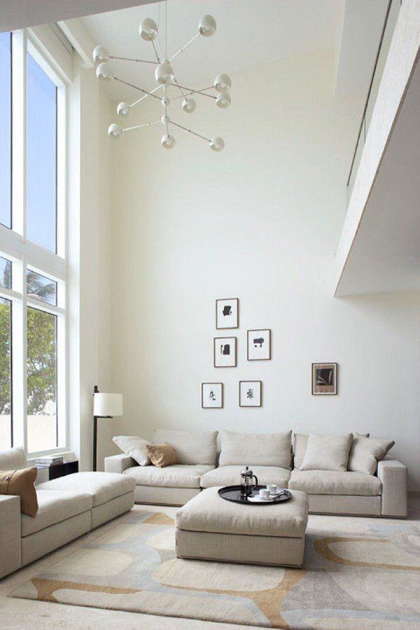 modern living room design pendant lamps wall art paintings wall