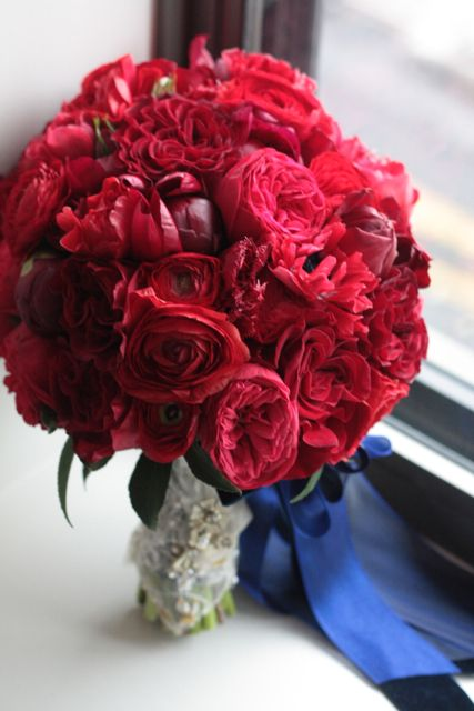 Red peony, red cabbage roses, red anemone, red tulips, red spray