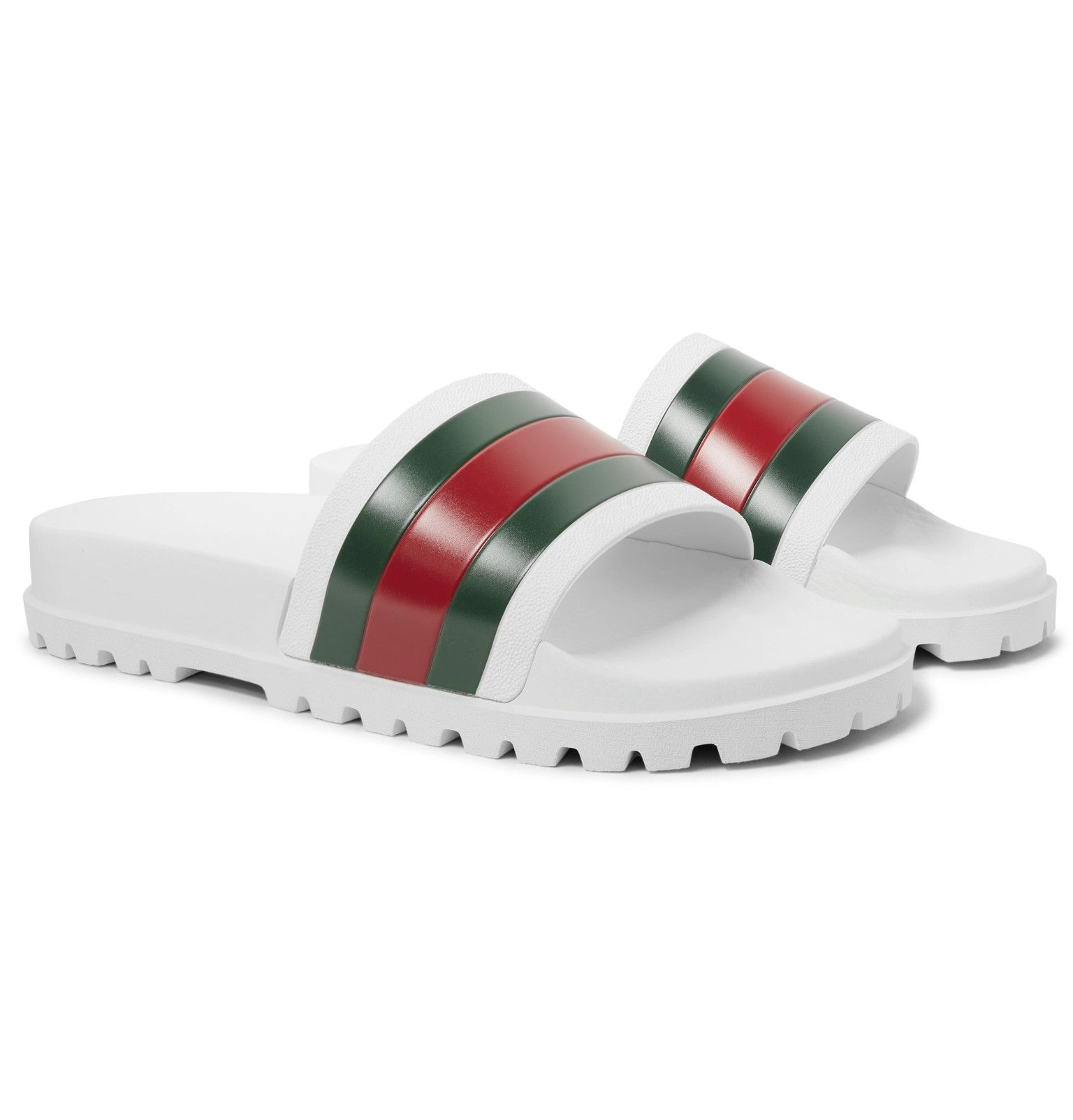 c3360f2f794 Gucci s Italian-made rubber slides boldly feature the brand s iconic  striping
