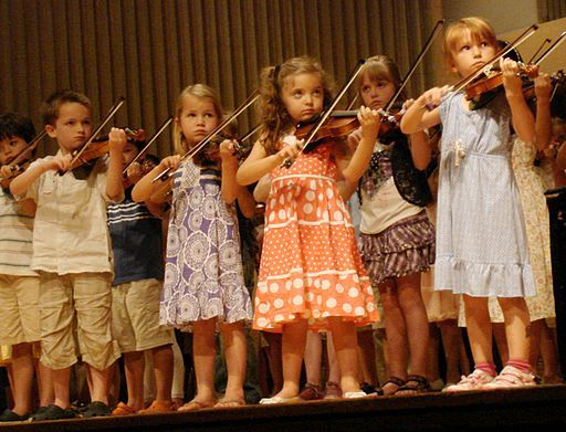 """Many difficulties can arise in children and young adults who love music, but feel stressed, pressured, or frustrated with their education. Amy Nathan, author of <em> The Music Parents' Survival Guide: A Parent-to-Parent Conversation</em>, offers tips, stories, and advice on how to overcome problems and nurture a child's interest in music. #education #music (Image: """"Children Playing Violin Suzuki Institute 2011"""" by Stilfehler. CC BY-SA 3.0 via Wikimedia Commons)"""