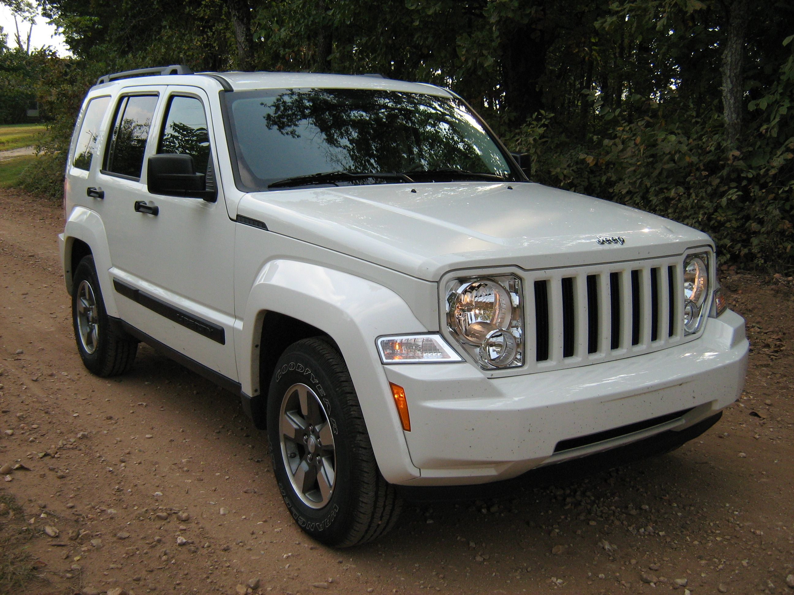 My CAR! White Jeep Liberty. I lOve it.
