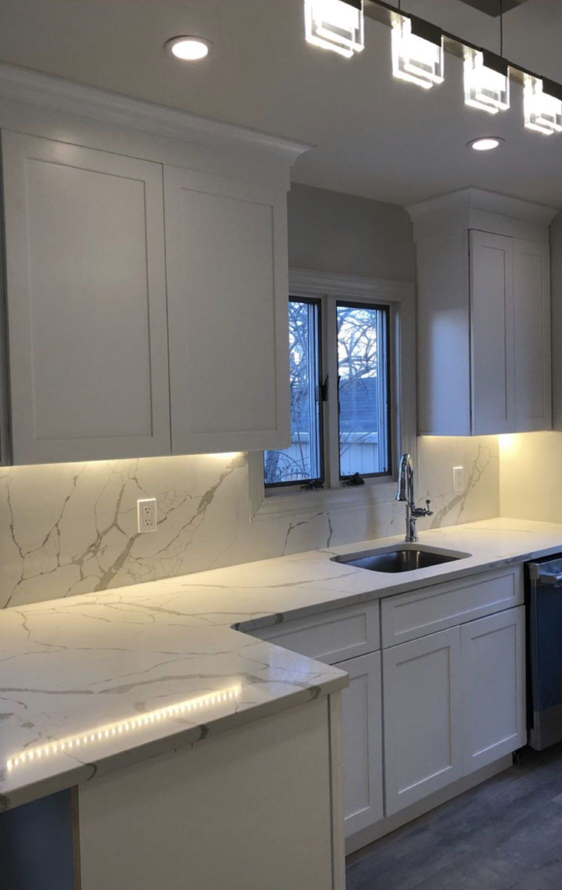 White Shaker Cabinetry With Marble Look Quartz Countertops And Full Height Backsplashes Kitchen Remodel Small Quartz Countertops Countertops