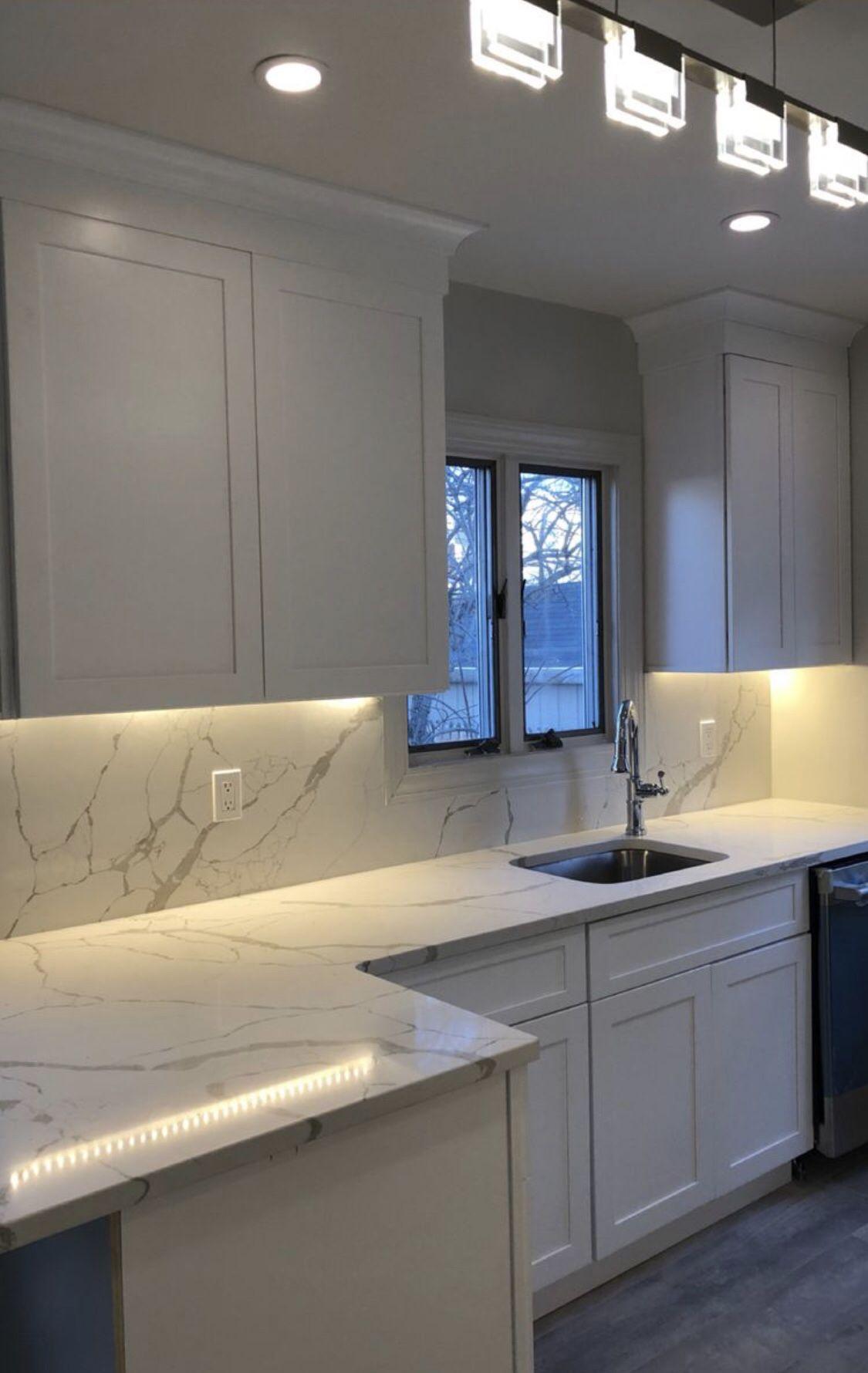 Fabuwood White Shaker Cabinetry With Msi Calacatta Laza Quartz