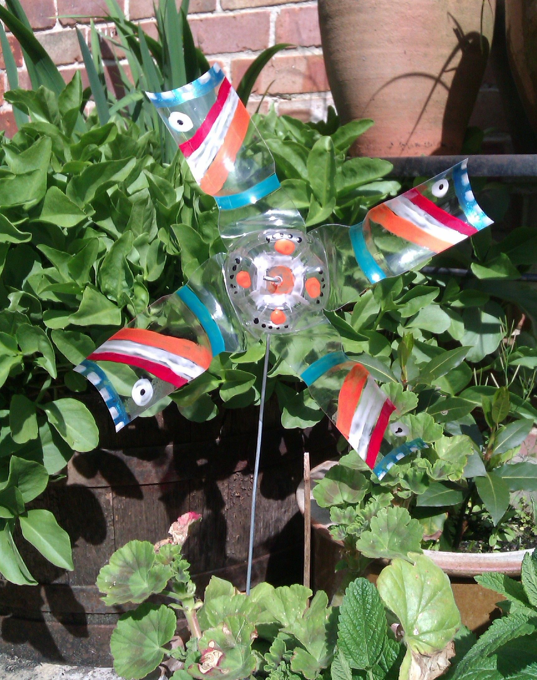 DIY garden windmill from a plastic bottle | Windmill, Plastic ...