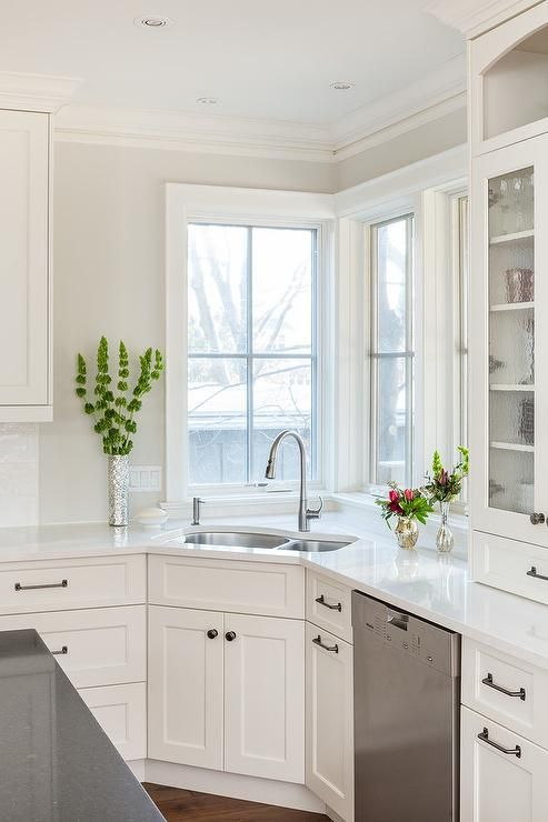 Beautiful Naturally Lit Kitchen Features A Corner Under Mount Sink Against A Set Of Tall Wh Kitchen Remodel Small Corner Sink Kitchen Farmhouse Kitchen Remodel