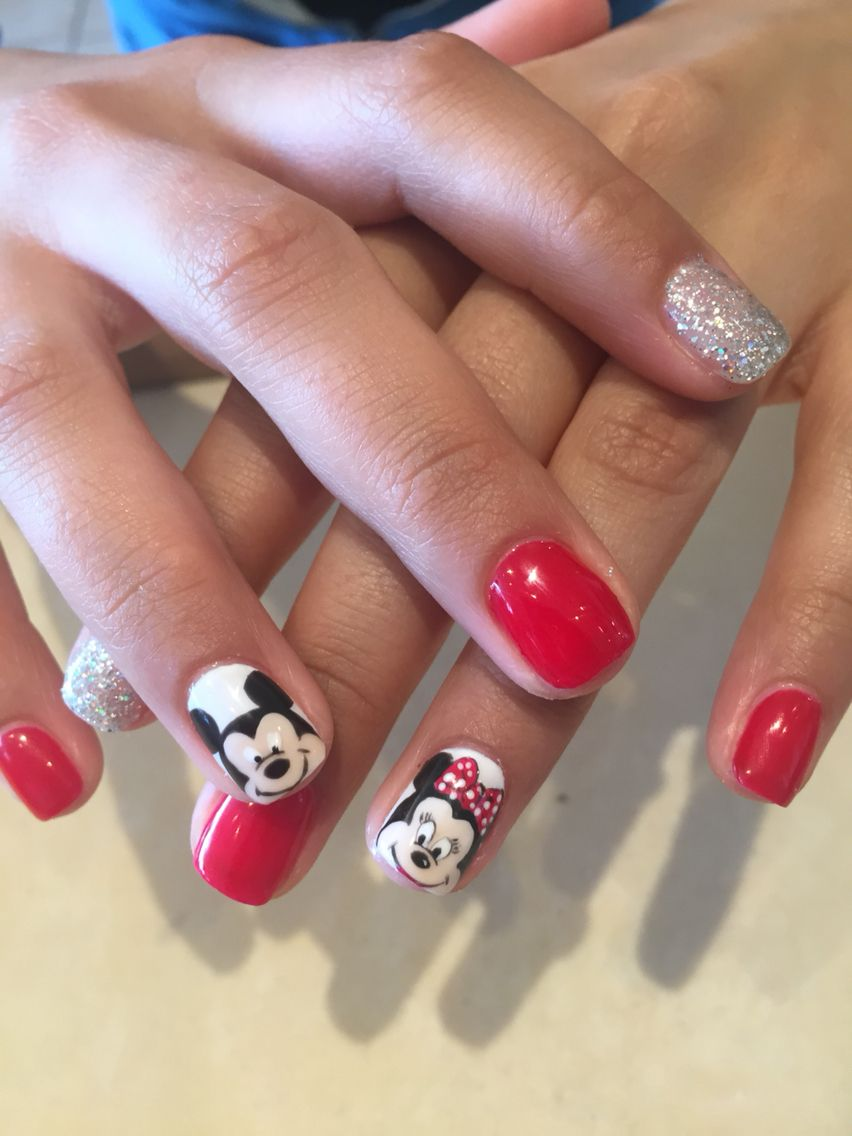 I used Gel Polish to hand painted the Mickey/Minnie mouse on Shellac ...