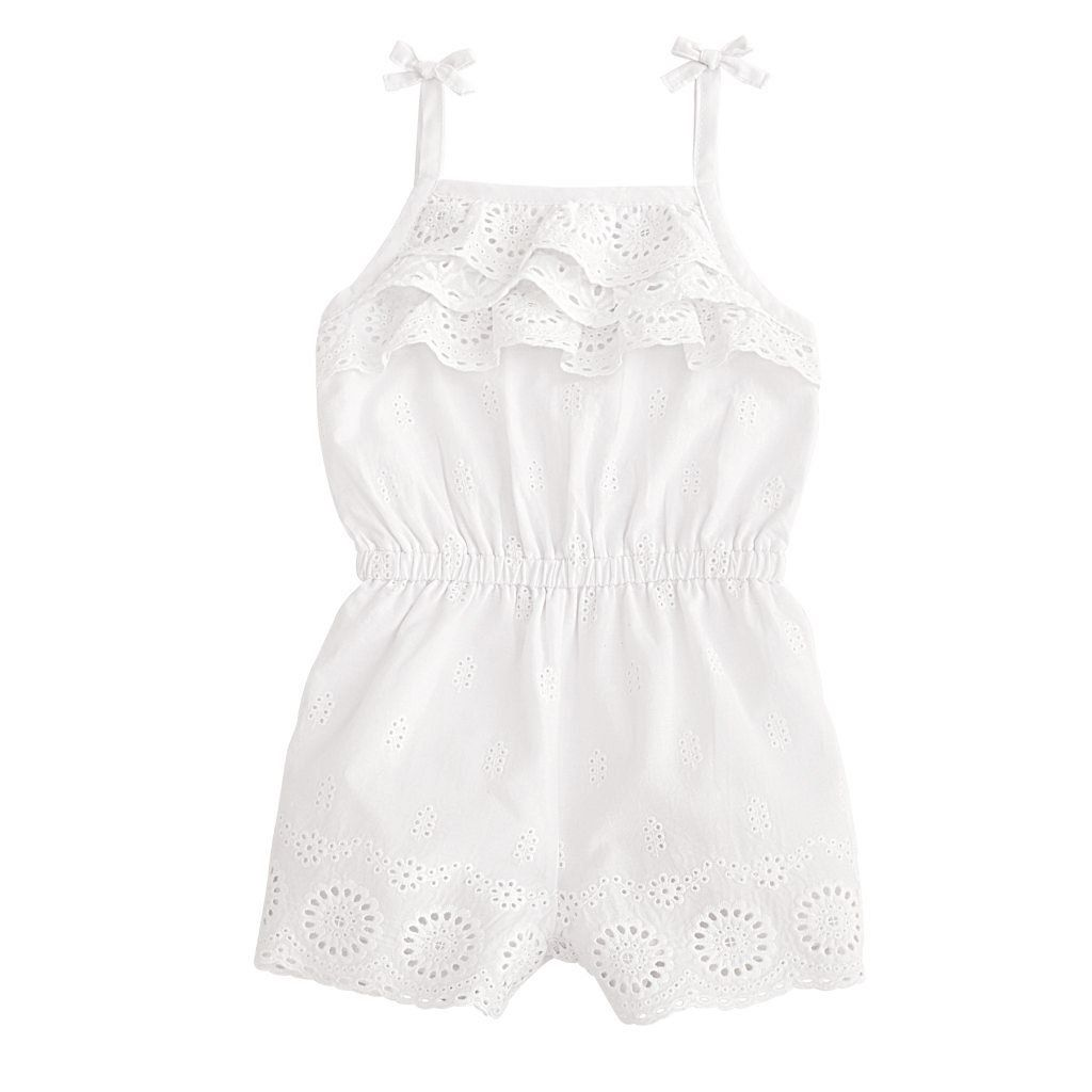 076a7959fb9 Lined white eyelet romper features tied and tacked bows at shoulder straps