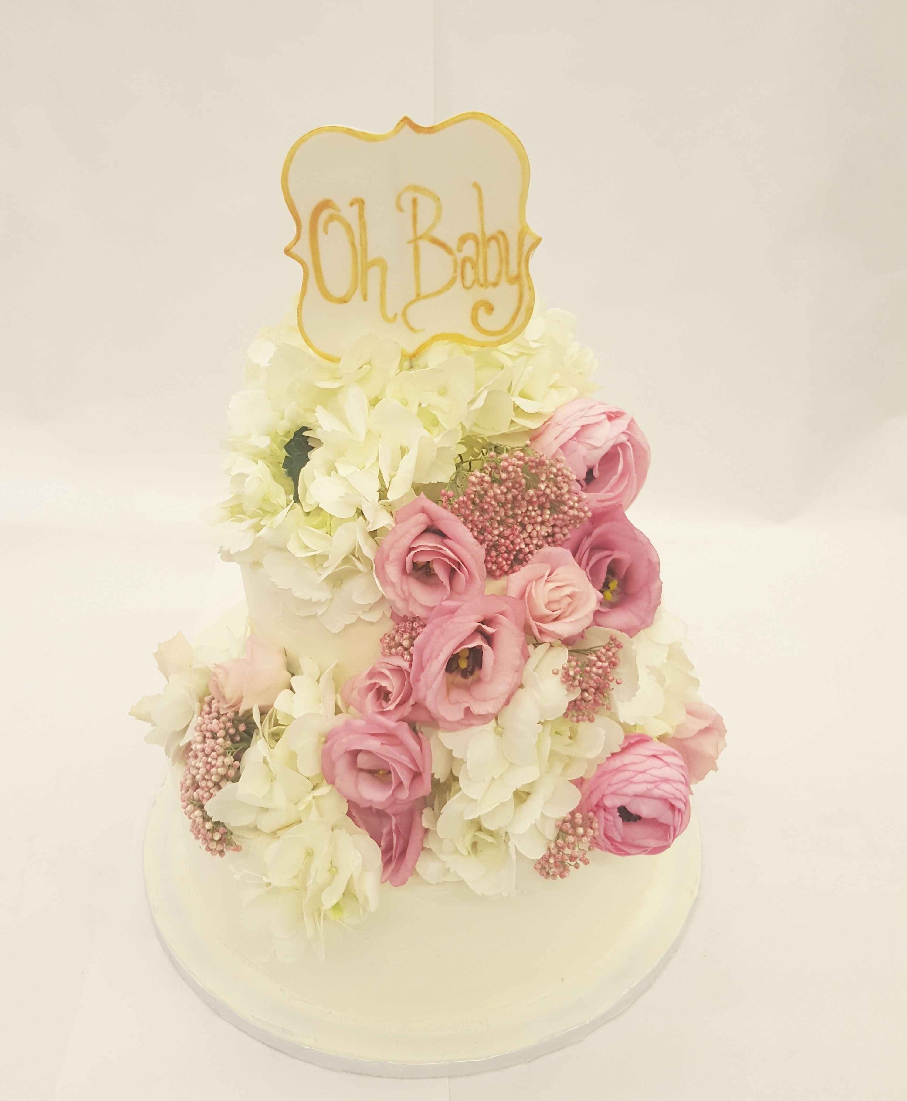 Oh Baby! Is this a beautiful cake. The more fresh flowers the better ...