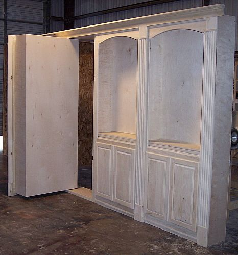 Construction of wall paneling with hidden door system