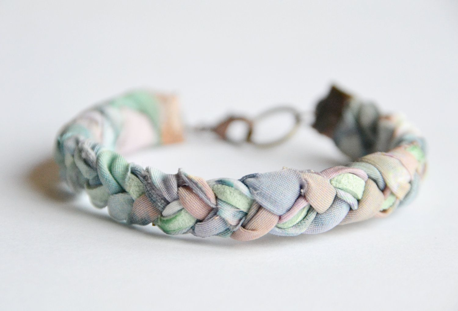 Fabric and suede bracelet. Pastel fabric braided with mint ...