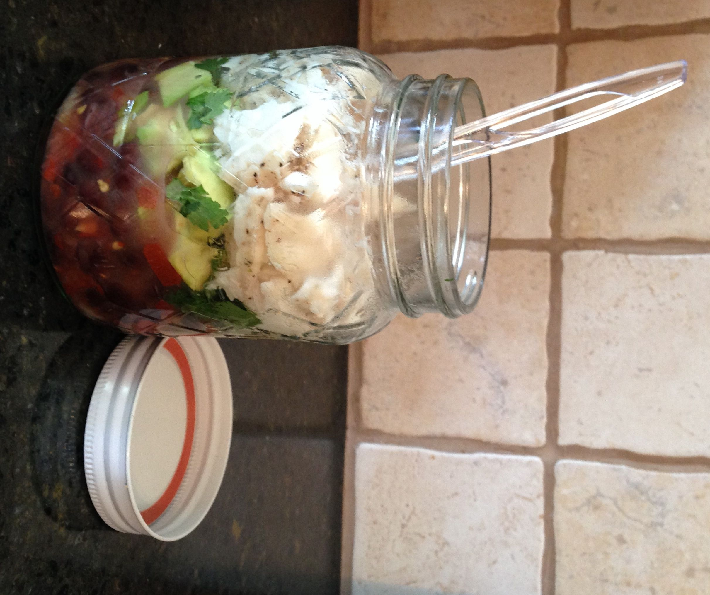Tailgating in a mason jar white fish with black bean salsa empty
