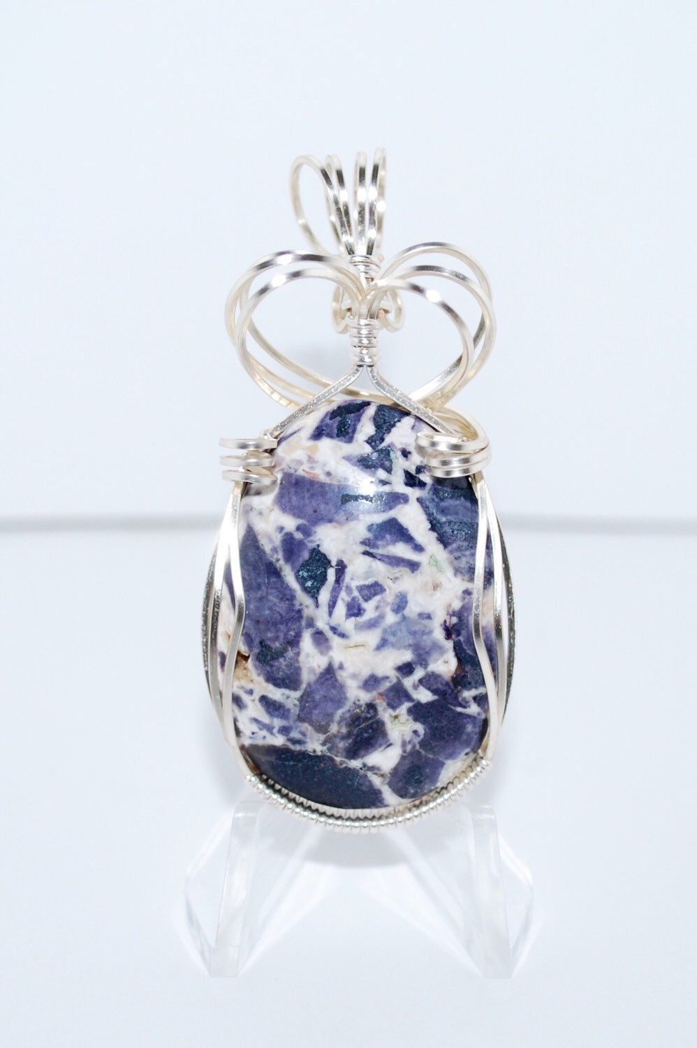 A personal favorite from my Etsy shop https://www.etsy.com/listing/254357115/beautiful-tiffany-stone-pendant-wrapped