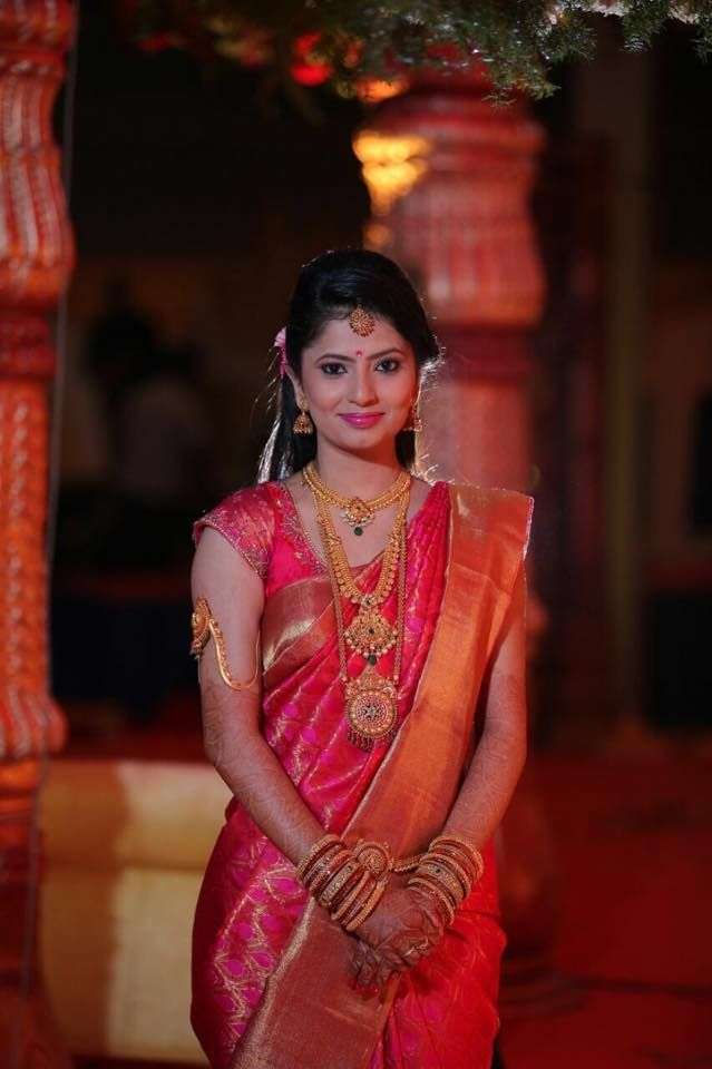 Traditional Southern Indian Bride Wearing Bridal Hair Saree And Jewellery