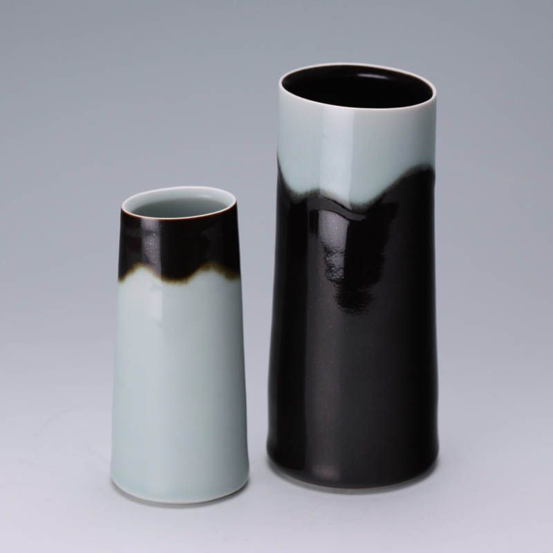 Small vases by Chris Keenan. Porcelain with tenmoku and celadon glaze. He works exclusively with these glazes. Very simple and beautiful.